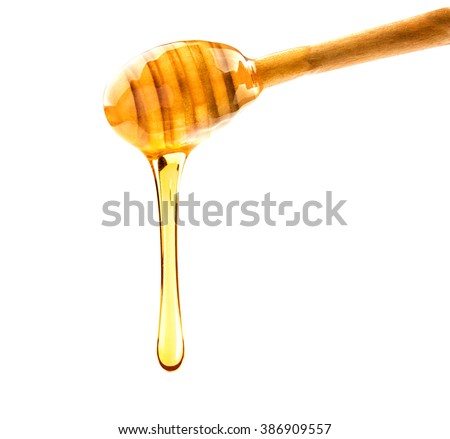 A drop of honey isolated on white background.