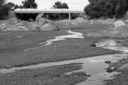 A droplet Running Down a Dry Riverbed in the Desert