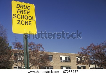 A drug free school zone sign