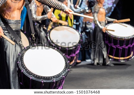 A Drummers are Performing on the Stage. Musicians are Drumming on the Drum Performance. Closeup View Of Man's Hands, Drums and Drumsticks.