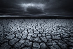A dry and barren landscape caused by climate change and global warming in black and white