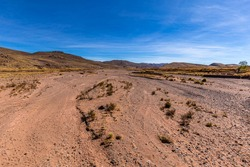 a dry riverbed somewhere on the road in bolivia.