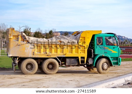 A dump truck moving on construction site