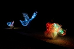 A duo baton show made of colorful LED lights with beautiful patterns that change as the lights twirling.