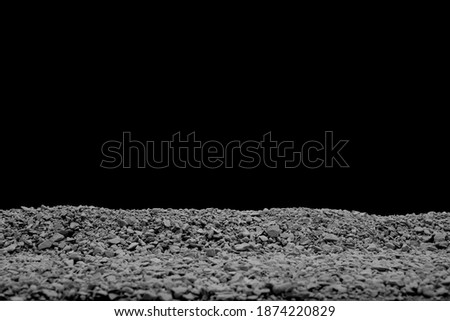 A Dusty Gravel Ridge, Showing a Blurred Foreground with Selective Focus to the Top Edge of the Small Aggregate on a Black Background. Stock photo ©