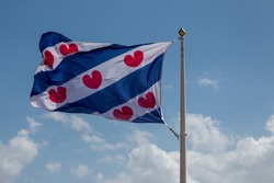 A Dutch flag that represents the province of Friesland, the red hearts symbolize lily leaves that are common in this province