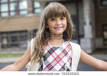 A eight years old school girl close to the schoolyards Stock photo ©