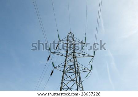 A electrical pylon with a blue sky