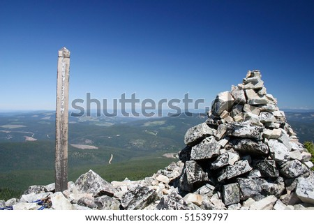 A elevation sign shows the 2272 Meters mark at the peak of mountain in manning park, Canada.