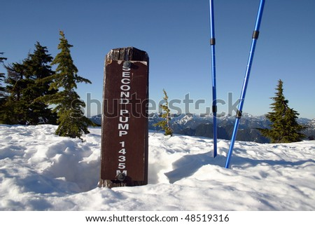 A elevation sign shows the 1435 Meters mark at the peak of Seymour mountain in Vancouver, Canada.