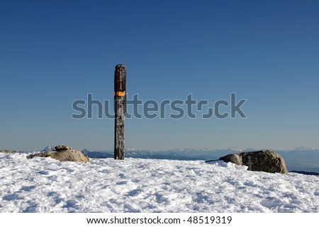 A elevation sign shows the 1455 Meters mark at the peak of Seymour mountain in Vancouver, Canada.