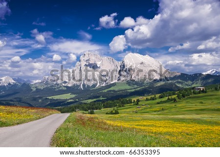 A empty road in Alpe Di Siusi, in the Italian Alps.