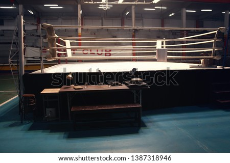 a empty setup boxing ring in small gym for shooting a movie