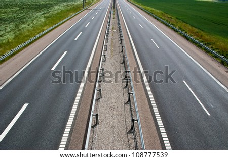 A empty stretch of a brand new two lane highway