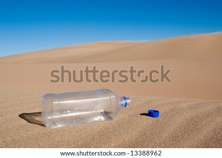 A Empty Water Bottle In The Middle Of The Desert Stock ...