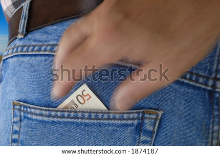 A 50 Euro bill poking out of the rear pocket of a traveller's jeans. Motion blur on a pickpocket's hand, about to take it.