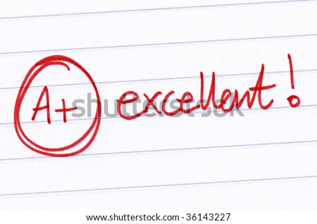 A+ excellent written on an exam paper. - stock photo