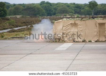 A explosion caused by military people - stock photo
