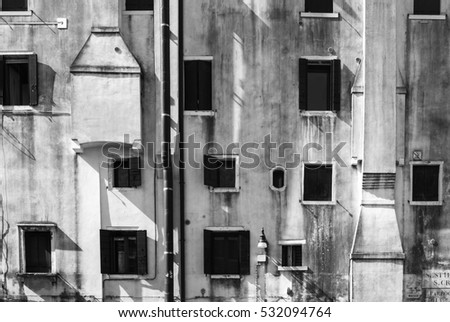 A facade with randomly arranged windows/window facade #532094764