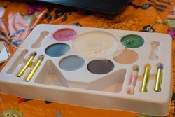 A facepainting kit for putting makeup on kids faces at parties