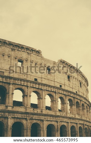 A faded orange vintage look of the Coliseum in Rome, Italy.