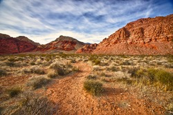 A faint dirt trail leads into the wilderness of Red Rocks Canyon State Park outside of Las Vegas, Nevada.