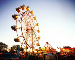 a fair ride during dusk on a warm summer evening