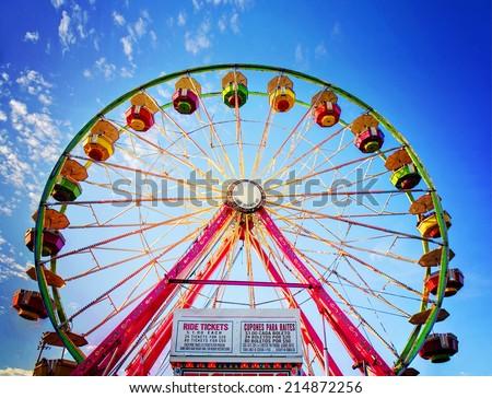 a fair ride during dusk on a warm summer evening