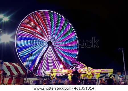 a fair ride shot with a long exposure at night and vintage instagram look
