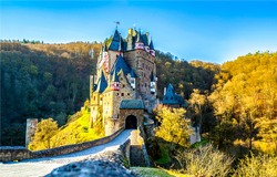 A fairytale castle in the autumn forest. Castle from faity tale. Castle in autumn forest. Autumn forest castle entrance