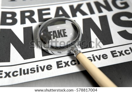 A fake news concept showing a printed newspaper with a magnifying glass highlighting an underlying message on the front page headline - 3D render