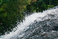 A fall of water is an area where water flows over a vertical drop or a series of steep drops in the course of a stream or river. Waterfalls also occur where meltwater...