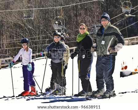 A family enjoying a holiday at the ski slopes.
