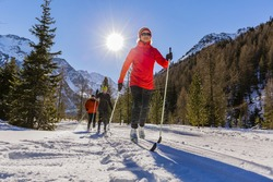 A family group of cross country skiers on a sunny winter morning in Italy Alps, Souty Tirol, Solda.