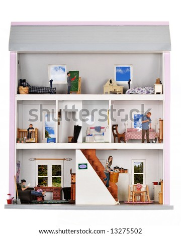 A family of five working and playing inside a furnished doll house.