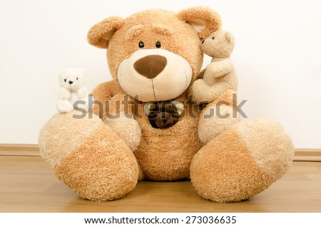A family of teddy bears, big bear protecting the smaller ones, bear toys