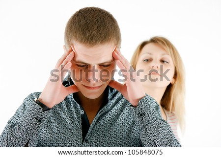 A family quarrel. A man tired of his wife's accusations - stock photo