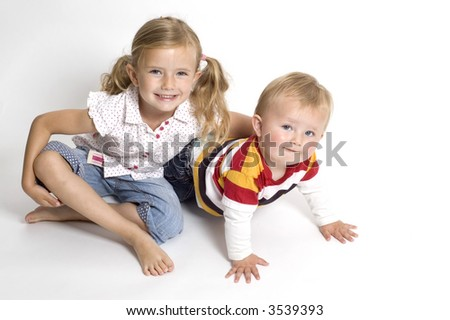 A family scene of a brother and sister sat together