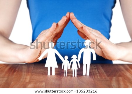 a family standing under a roof of a house build of hands