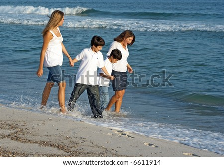 A family walking together on the Alabama gulf coast.