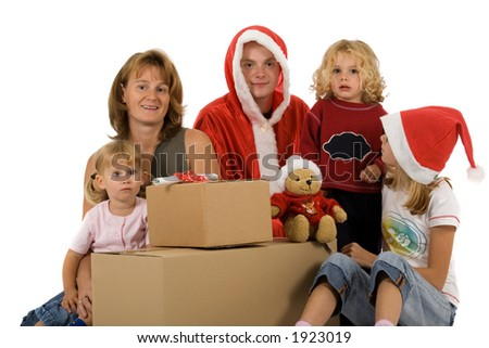 a family with christmas hats and big cardboard boxes