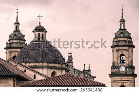 A famous cathedral in Bogota, Colombia, with a red sky behind it