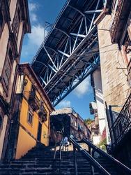 A famous steel bridge dom Luis above connects Old town, Porto, with Vila Nova de Gaia at river Douro, Portugal.