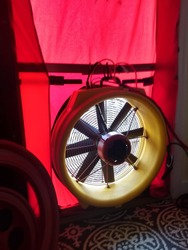 A fan in a doorway for a blower door test.