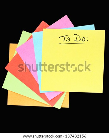 "A fan of colorful post-it notes, ""To do"" lettering, black background"