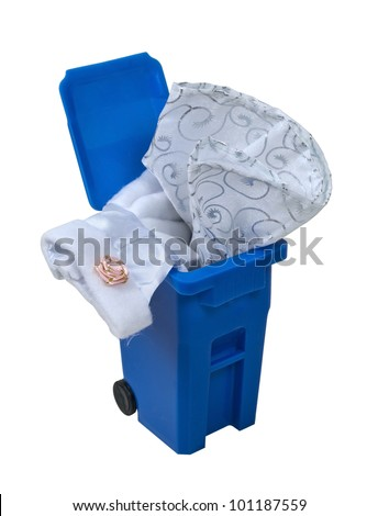 A fancy formal white dress with flowers and lace in a blue recycling bin - path included