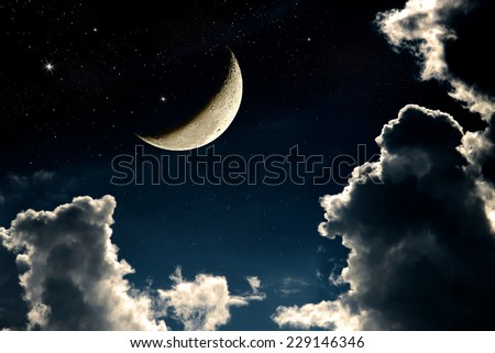 A fantasy of night sky cloudscape with stars and a crescent moon overlaid, vintage color toned