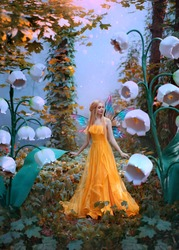 A fantasy woman forest fairy. Fashion model in yellow dress with butterfly wings walks in autumn nature. Large flowers scenery decor white lily of the valley. Orange leaves of tree blue mystical fog