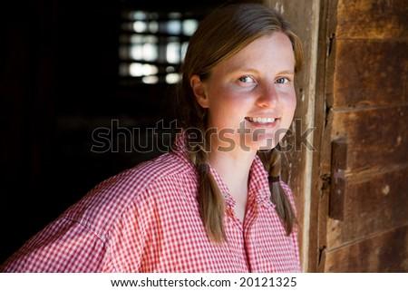 A farm girl worker taking a break