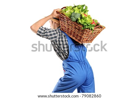 A farmer carrying a basket of vegetables on his back isolated on white background